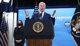 President Joe Biden speaks about COVID-19 vaccinations and response, in the South Court Auditorium on the White House campus, Monday, March 29, 2021, in Washington, as Vice President Kamala Harris listens. (AP Photo/Evan Vucci)