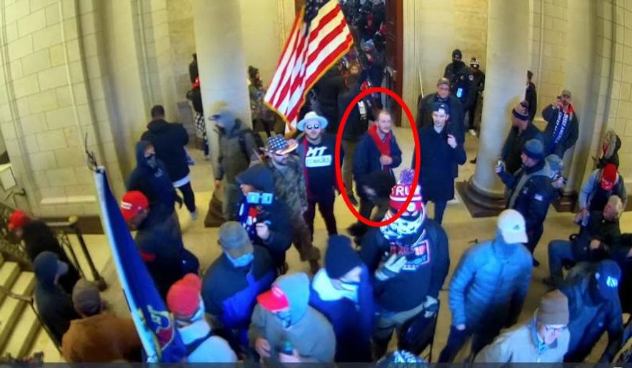 In this image taken from U.S. Capitol Police security camera footage released in a criminal complaint and filed with the U.S. District Court for the District of Columbia, Ethan Seitz, 31, of Bucyrus, Ohio, outlined in red by the source, joins other rioters who stormed the U.S. Capitol on Jan. 6, 2021, in Washington. Seitz was arrested on March 19 on preliminary charges of illegally entering a restricted building, and violent entry and disorderly conduct on Capitol grounds. More than 300 supporters of former President Donald Trump have been charged in the storming of the U.S. Capitol and at least 16 Ohioans are among those charged. (U.S. District Court-District of Columbia via AP)