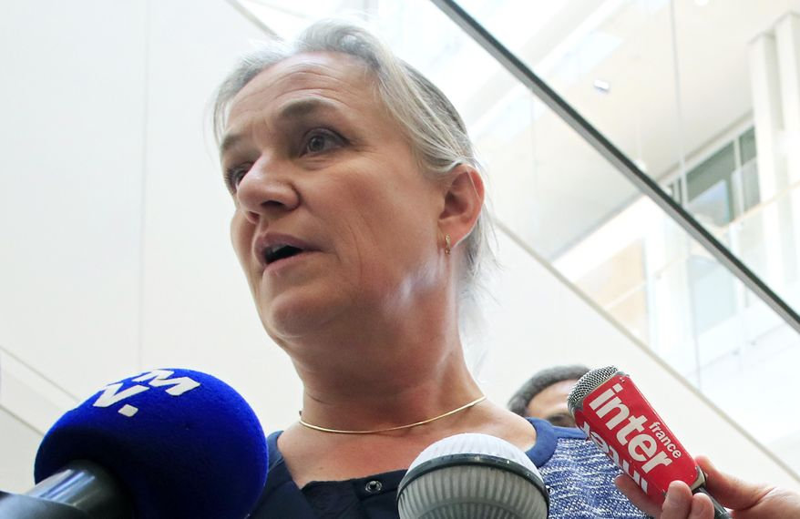 FILE - In this Monday, Sept. 23, 2019 file photo, Doctor Irene Frachon, who discovered that the drug Mediator could have fatal side effect, speaks to reporters as she arrived at a Paris courthouse. A Paris court will deliver its verdict Monday, March 29, 2021 in a case that grew into one of France's biggest modern health scandals, ruling whether a French pharmaceutical company is guilty of manslaughter and other charges for selling a diabetes drug blamed for hundreds of deaths. Accused of favoring profits over patients' lives, Servier Laboratories is facing millions of euros in potential fines and damages after a huge trial involving 6,500 plaintiffs. (AP Photo/Michel Euler, File)