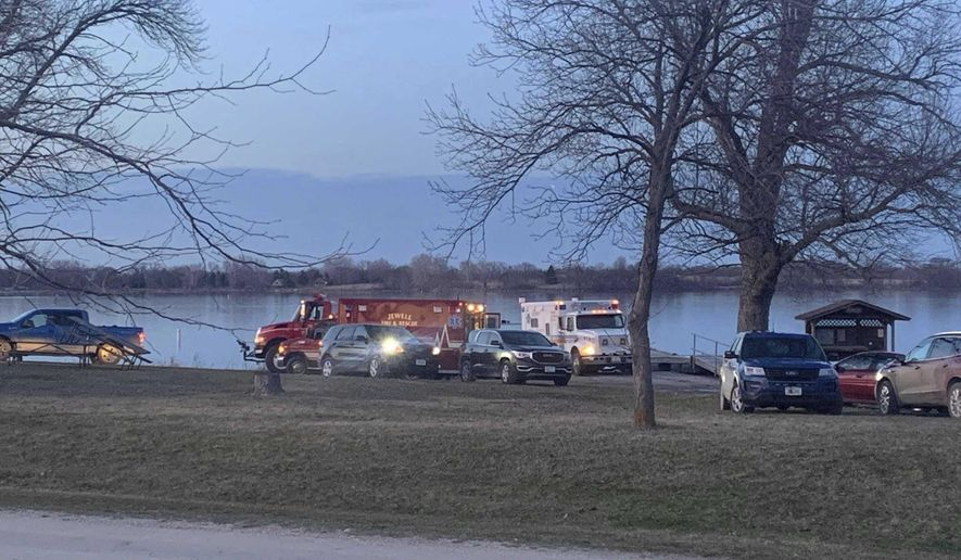 Responders and search crews gather at Little Wall Lake Sunday evening, March 28, 2021, after five members of the Iowa State Crew Club were involved in a boating accident earlier in the morning. (Amber Mohmand/The Des Moines Register via AP)