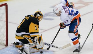Pittsburgh Penguins goaltender Casey DeSmith (1) stops a shot by New York Islanders' Casey Cizikas (53) during the third period of an NHL hockey game, Monday, March 29, 2021, in Pittsburgh. (AP Photo/Keith Srakocic)
