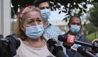 Rosibel Emerita Arriaza, the mother of Victoria Esperanza Salazar who died in police custody, talks to the press in Antiguo Cuzcatlan, El Salvador, Monday, March 29, 2021. Mexican authorities said Monday that an autopsy of Arriaza's daughter confirmed that police broke her neck in the Caribbean resort of Tulum, Mexico. (AP Photo/Salvador Melendez)