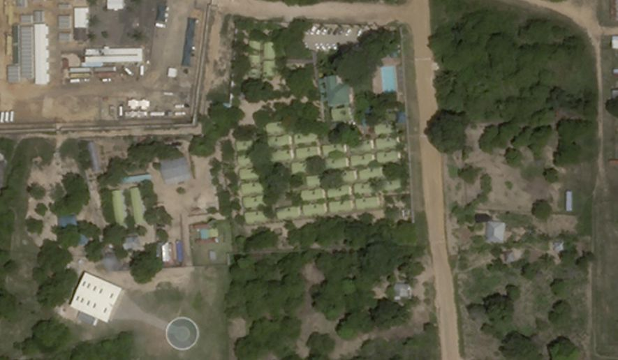 This satellite photo from Planet Labs Inc. shows the Amarula Palma hotel, center, with its helipad below left, in Palma, Mozambique, on Thursday, Jan. 7, 2021.  An estimated 200 Mozambicans and foreign workers had been sheltering at the hotel but by Monday, March 29, 2021 the hotel was empty as fierce fighting for control of Mozambique's strategic northern town of Palma persisted into its sixth day with heavily armed rebels fighting army, police and a private military outfit in several spots. (Planet Labs Inc. via AP)