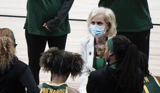 Baylor head coach Kim Mulkey talks to her players during the first half of an NCAA college basketball game against UConn in the Elite Eight round of the Women's NCAA tournament Monday, March 29, 2021, at the Alamodome in San Antonio. (AP Photo/Morry Gash)