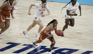 Texas's Kyra Lambert heads for the basket after a steal during the second half of an NCAA college basketball game against Maryland in the Sweet 16 round of the Women's NCAA tournament Sunday, March 28, 2021, at the Alamodome in San Antonio. (AP Photo/Morry Gash)