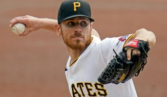 FILE - Pittsburgh Pirates starting pitcher Chad Kuhl delivers during the top of the second inning of a baseball game against the Chicago Cubs in Pittsburgh, in this Thursday, Sept. 24, 2020, file photo. Kuhl will be the Pirates opening day pitcher. (AP Photo/Gene J. Puskar, File)