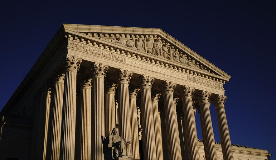 In this Nov. 2, 2020, file photo the Supreme Court is seen at sundown in Washington.   (AP Photo/J. Scott Applewhite, File)