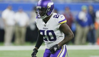 FILE - Minnesota Vikings cornerback Mackensie Alexander waits on the snap during the second half of an NFL football game against the Detroit Lions in Detroit, in this Sunday, Oct. 20, 2019, file photo. The Vikings have added more seasoning to their secondary by agreeing to contract terms with cornerback Mackensie Alexander and safety Xavier Woods. (AP Photo/Duane Burleson, File)