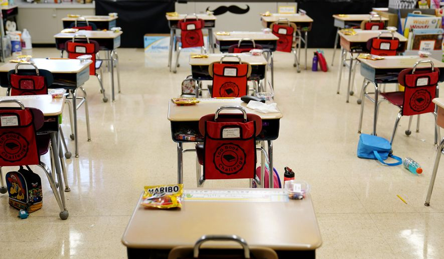 Desks are arranged in a classroom at Panther Valley Elementary School, Thursday, March 11, 2021, in Nesquehoning, Pa. (AP Photo/Matt Slocum)