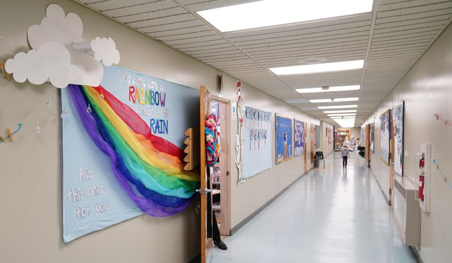 A memorial dedicated to former student Ava Lerario is posted in a hallway at Panther Valley Elementary School, Thursday, March 11, 2021, in Nesquehoning, Pa. On May 26, 2020, former student, 9-year-old Ava Lerario; her mother, Ashley Belson, and Ava's father, Marc Lerario, were found fatally shot inside their home. (AP Photo/Matt Slocum)