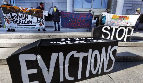 In this Jan. 13, 2021, photo, tenants' rights advocates demonstrate in front of the Edward W. Brooke Courthouse in Boston. President Joe Biden's administration is cutting things close on a nationwide eviction moratorium, which is set to expire in less than a week. (AP Photo/Michael Dwyer) **FILE**