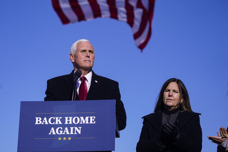 In this Jan. 20, 2021, photo, former Vice President Mike Pence speaks after arriving back in his hometown of Columbus, Ind., as his wife Karen watches. Pence is steadily reentering public life as he eyes a potential run for the White House in 2024. He's writing op-eds, delivering speeches, preparing trips to early voting states and launching an advocacy group likely to focus on promoting the accomplishments of the Trump administration. (AP Photo/Michael Conroy) **FILE**