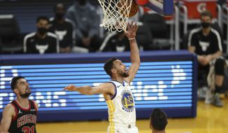 Golden State Warriors guard Steph Curry shoots against Chicago Bulls guard Tomas Satoransky (left) during the first half of an NBA basketball game in San Francisco, Monday, March 29, 2021. (AP Photo/Jed Jacobsohn)