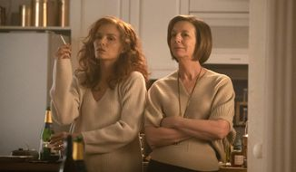 """This image released by Sony Pictures Classics shows Michelle Pfeiffer, left, and Susan Coyne in a scene from """"French Exit."""" (Jerome Prebois/Sony Pictures Classics via AP)"""