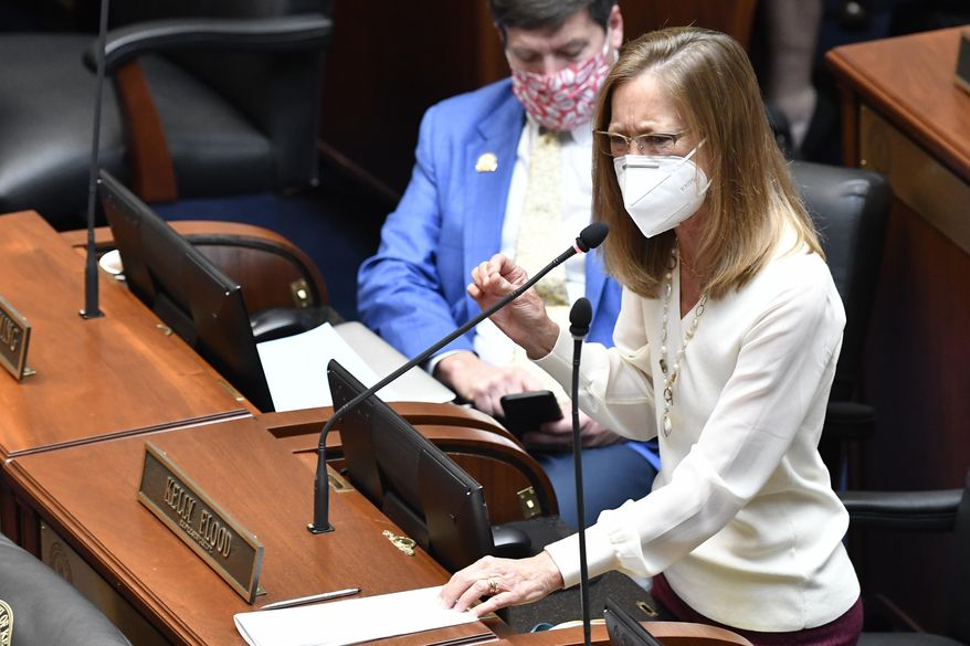 Kentucky State Rep. Kelly Flood, addresses members of the Ky. House about Ky. Senate Bill 4, an act relating to warrants authorizing entry without notice during the last day of the State Legislature at the Kentucky State Capitol in Frankfort, Ky., Tuesday, March 30, 2021. (AP Photo/Timothy D. Easley)