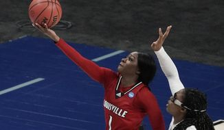Louisville's Dana Evans shoots past Stanford's Francesca Belibi during the first half of an NCAA college basketball game in the Elite Eight round of the Women's NCAA tournament Tuesday, March 30, 2021, at the Alamodome in San Antonio. (AP Photo/Morry Gash)
