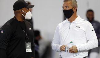 Jackson Jaguars coach and former Ohio State coach Urban Meyer talks with Eagles assistant Brian Johnson during an NFL Pro Day at Ohio State University Tuesday, March 30, 2021 in Columbus, Ohio. (AP Photo/Paul Vernon)
