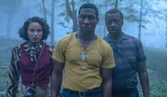 """This image released by HBO shows Jurnee Smollett, from left, Jonathan Majors and Courtney B. Vance in a scene from """"Lovecraft Country.""""  """"The Queen's Gambit,"""" """"Lovecraft Country"""" and """"What We Do in the Shadows"""" are among the series featured in a virtual edition of the Paley Center's annual festival. The event celebrates TV programs and their stars and producers. (HBO via AP)"""