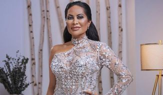 """This image released by Bravo shows Jen Shah, a cast member from the reality series """"The Real Housewives of Salt Lake City."""" Authorities announced that Shah and Stuart Smith were arrested Tuesday in Utah on federal fraud charges. (Chad Kirkland/Bravo via AP)"""