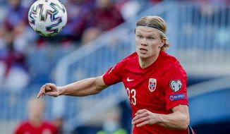 Norway's Erling Haaland controls the ball during a World Cup 2022 group G qualifying soccer match between Norway and Turkey at La Rosaleda stadium in Malaga, Spain, Saturday, March 27, 2021. (AP Photo/Fermin Rodriguez)