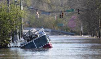 A Nashville Fire Department truck is revealed as flood waters from the Harpeth River recede Monday, March 29, 2021, in Nashville, Tenn. Recent storms dropped seven inches of rain in the area that resulted in flooding and flash flooding across the city. (George Walker IV, The Tennessean via AP)