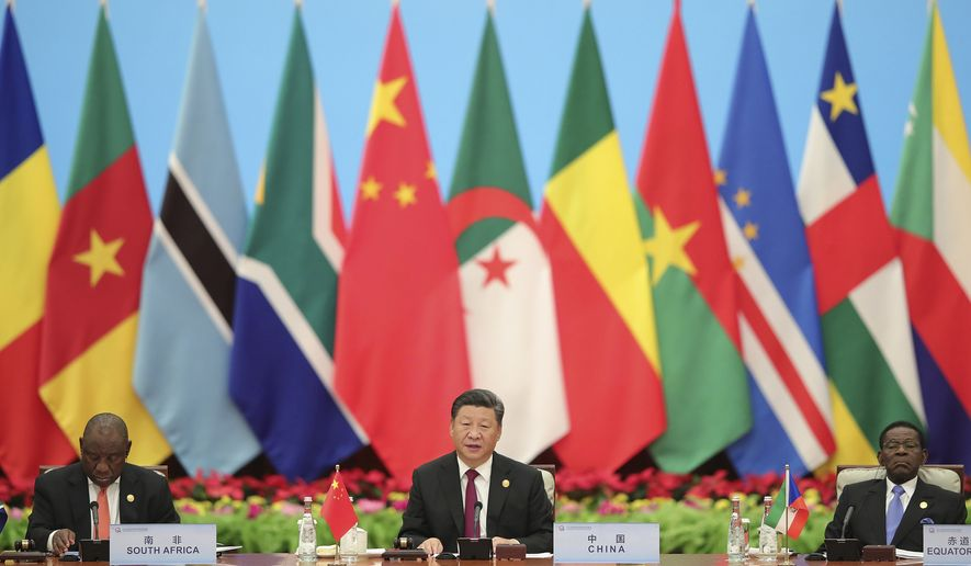 FILE - In this Sept. 4, 2018, file photo, Chinese President Xi Jinping speaks with South African President Cyril Ramaphosa, left, during the 2018 Beijing Summit of the Forum on China-Africa Cooperation - Round Table Conference at the Great Hall of the People in Beijing. China's loans to poor countries in Africa and Asia impose unusual secrecy and repayment terms that are hurting their ability to renegotiate debts after the coronavirus pandemic, a group of U.S. and German researchers said in a report Wednesday, March 31, 2021. (Lintao Zhang/Pool photo via AP, File)