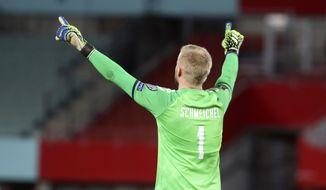 Denmark's Kasper Schmeichel reacts after a goal against Austria during the World Cup 2022 group F qualifying soccer match between Austria and Denmark at Ernst-Happel-Stadium in Vienna, Austria, Wednesday, March 31, 2021. (AP Photo/Ronald Zak)