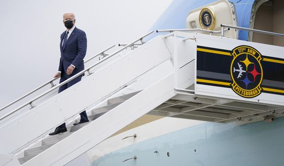President Joe Biden arrives at Pittsburgh International Airport ahead of a speech on infrastructure spending, Wednesday, March 31, 2021, in Pittsburgh. (AP Photo/Evan Vucci)