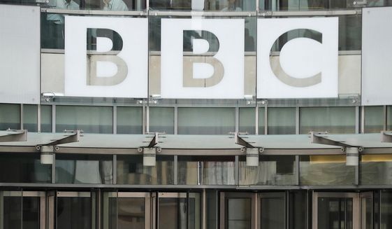 This file photo dated Wednesday, July 19, 2017, shows the BBC sign outside the entrance to the headquarters of the publicly funded media organization in London. (AP Photo/Frank Augstein, FILE)