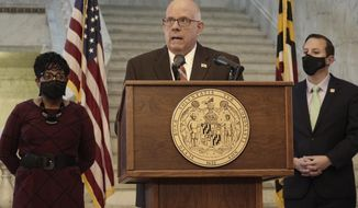 Maryland Gov. Larry Hogan, a Republican, announces a bipartisan budget agreement to allocate $3.9 billion in federal funding that the state expects to receive through the American Rescue Plan Act during a news conference with legislative leaders on Wednesday, March 31, 2021 in Annapolis. House Speaker Adrienne Jones, a Democrat, is standing left, and Senate President Bill Ferguson, a Democrat, is standing right.  (AP Photo/Brian Witte)