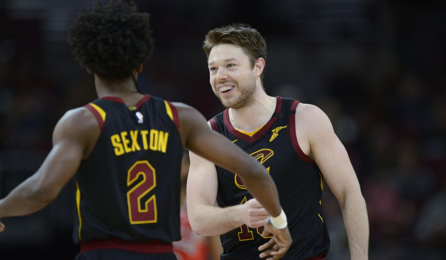 FILE - Cleveland Cavaliers' Matthew Dellavedova of Australia, celebrates with teammate Collin Sexton (2) during the second half of an NBA basketball game against the Chicago Bulls in Chicago, in this Tuesday, March 10, 2020, file photo. Chicago won 108-103. Dellavedova may make his long-awaited season debut after being out with a concussion and appendectomy. Coach J.B. Bickerstaff said Dellavedova practiced on Wednesday, March 31, 2021, and as long as he gets final medical clearance, the 30-year-old will play against Philadelphia on Thursday .(AP Photo/Paul Beaty, File)