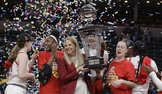 Maryland head coach Brenda Frese celebrates with her team after they defeated Ohio State to win the NCAA college basketball championship game at the Big Ten Conference tournament in Indianapolis, in this Sunday, March 8, 2020, file photo.Maryland coach Brenda Frese was honored as The Associated Press women's basketball coach of the year Wednesday, March 31, 2021, for the second time in her career.  (AP Photo/Darron Cummings, File) **FILE**