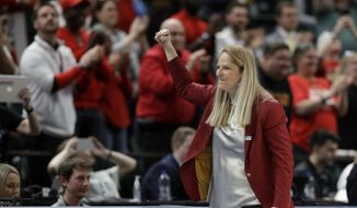 Maryland head coach Brenda Frese reacts after Maryland defeated Ohio State to win the NCAA college basketball championship game at the Big Ten Conference tournament in Indianapolis, in this Sunday, March 8, 2020, file photo. Maryland coach Brenda Frese was honored as The Associated Press women's basketball coach of the year Wednesday, March 31, 2021, for the second time in her career. (AP Photo/Darron Cummings, File) **FILE**