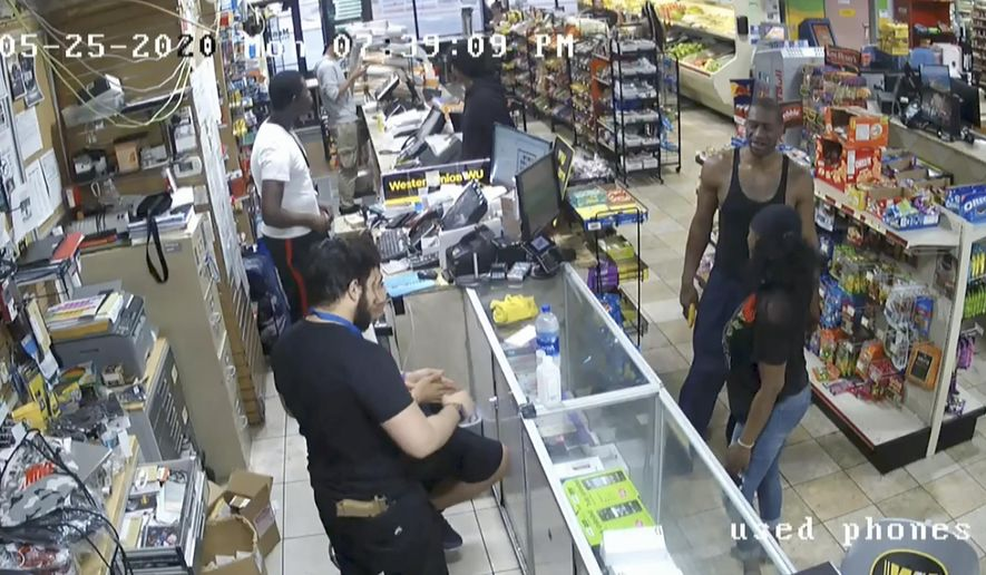 In this image from store video, George Floyd, right, is seen inside Cup Foods on May 25, 2020, in Minneapolis.  Former Minneapolis Police officer Derek Chauvin is on trial for the death of Floyd at the Hennepin County Courthouse in Minneapolis, Minn. (Court TV via AP, Pool)