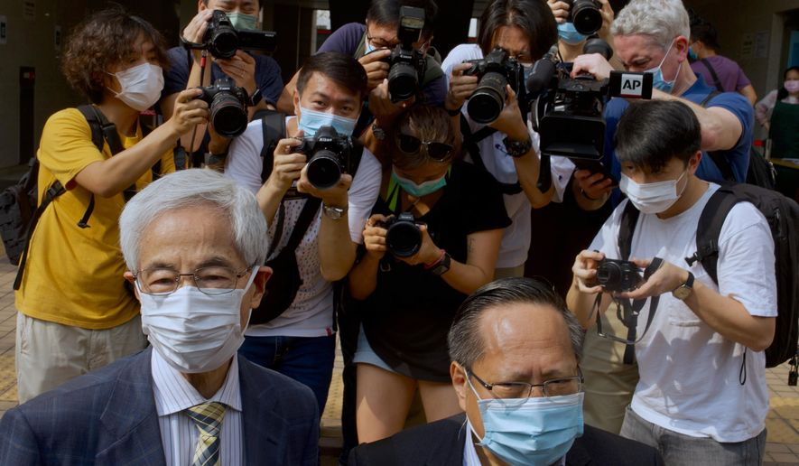 Pro-democracy lawmaker Martin Lee, left, and Albert Ho arrive at a court in Hong Kong Thursday, April 1, 2021. Seven pro-democracy advocates, including media tycoon Jimmy Lai and veteran of the city's democracy movement Lee, are expected to be handed a verdict for organizing and participating in an illegal assembly during massive anti-government protests in 2019 as Hong Kong continues its crackdown on dissent. (AP Photo/Vincent Yu)