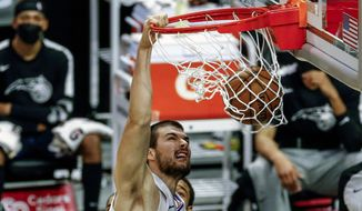 Los Angeles Clippers' Ivica Zubac (40) dunks against the Orlando Magic during the first half of an NBA basketball game, Tuesday, March 30, 2021, in Los Angeles. (AP Photo/Ringo H.W. Chiu)