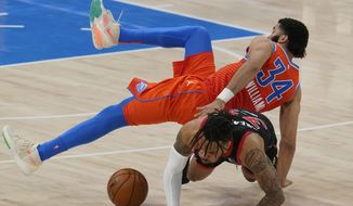 Oklahoma City Thunder forward Kenrich Williams (34) and Toronto Raptors guard Gary Trent Jr., bottom, collide and fall to the floor in the first half of an NBA basketball game Wednesday, March 31, 2021, in Oklahoma City. (AP Photo/Sue Ogrocki)