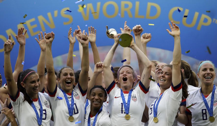 FILE - In this July 7, 2019, file photo, United States' Megan Rapinoe lifts up a trophy after winning the Women's World Cup final soccer match between U.S. and The Netherlands at the Stade de Lyon in Decines, outside Lyon, France. The 2023 Women's World Cup will be spread across nine cities in Australia and New Zealand. (AP Photo/Alessandra Tarantino, File)