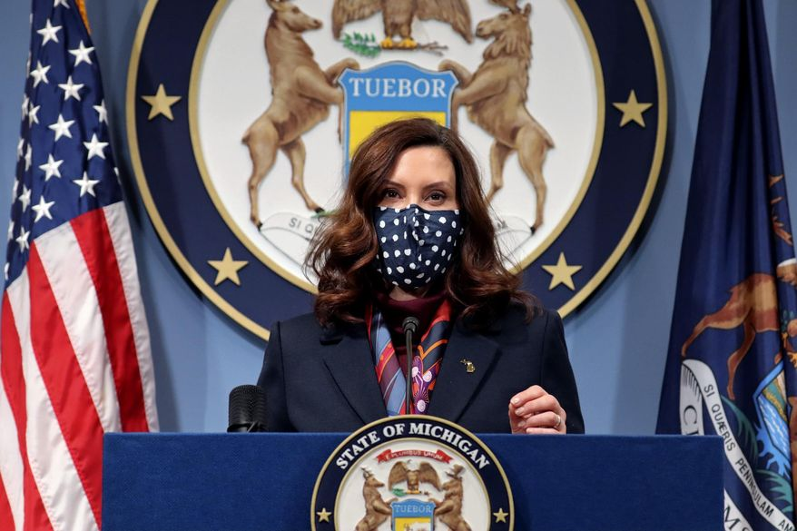 This March 2, 2021 file photo provided by the Michigan Office of the Governor, Gov. Gretchen Whitmer addresses the state during a speech in Lansing, Mich. (Michigan Office of the Governor via AP, File)  **FILE**