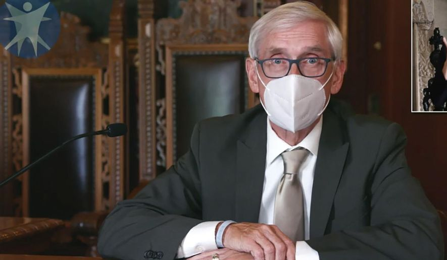 This July 30, 2020, image taken from video by the Wisconsin Department of Health Services shows Wisconsin Gov. Tony Evers in Madison, Wis. The Wisconsin Supreme Court on Wednesday, March 31, 2021, struck down Gov. Evers' statewide mask mandate, ruling that the Democrat exceeded his authority by issuing the order. The 4-3 ruling from the conservative-controlled court is the latest legal blow to attempts by Evers to control the coronavirus. (Wisconsin Department of Health Services via the AP, File)