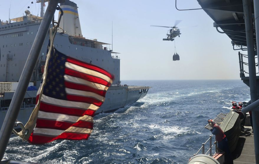 In this file photo, an SH-60B Sea Hawk helicopter assigned to the Vipers of Helicopter Anti-Submarine Squadron Light (HSL) 48, carries pallets of supplies to the flight deck of the guided-missile cruiser USS Monterey. The Monterey, along with the USS Thomas Hudner, participated last month in Sea Shield 2021, a multinational Black Sea naval exercise hosted by Romania. (U.S. Navy photo) **FILE**