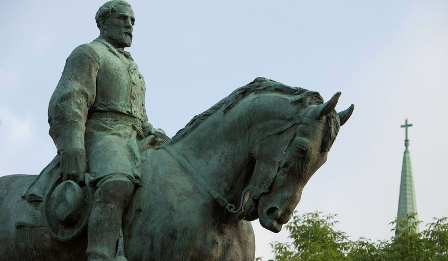 The statue of Confederate Army of Northern Virginia Gen. Robert E. Lee stands in Emancipation Park in Charlottesville, Va., Friday, Aug. 18, 2017. (AP Photo/Cliff Owen)