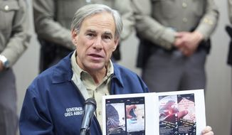 Texas Governor Greg Abbott displays screen shots of TikTok videos used by organized crime to recruit members gathered by law enforcement as he talks about Operation Lone Star during a press conference Texas Department of Public Safety Weslaco Regional Office on Thursday, April 1, 2021, in Weslaco, Texas. (Joel Martinez/The Monitor via AP) **FILE**