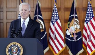 President Joe Biden speaks after meeting with leaders from Georgia's Asian-American and Pacific Islander community, at Emory University in Atlanta, in this Friday, March 19, 2021, file photo. Georgia's new voting law _ which critics claim severely limits access to the ballot box, especially for people of color _ has prompted calls from as high as the White House to consider moving the midsummer classic out of Atlanta. The game is set for July 13 at Truist Park, the Braves' 41,000-seat stadium in suburban Cobb County. (AP Photo/Patrick Semansky) **FILE**