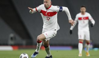 Turkey's Burak Yilmaz runs with the ball during the World Cup 2022 group G qualifying soccer match between Turkey and Netherlands at the Ataturk Olimpiyat Stadium in Istanbul, Turkey, Wednesday, March 24, 2021. (Murad Sezer/Pool Photo via AP)