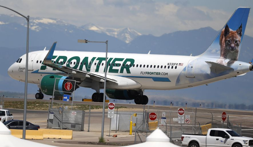 FILE - In this June 10, 2020 file photo, a Frontier Airlines jet heads down a runway for take off from Denver International Airport as travelers deal with the effects of the new coronavirus in Denver.  Fans of Frontier Airlines can now buy a piece of the budget carrier. Frontier shares were expected to begin public trading Thursday, April 1, 2021, and company executives are hoping to get a tailwind from what seems to be a recovery in air travel.   (AP Photo/David Zalubowski, File)