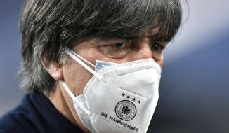 Germany head coach Joachim Low stands on the pitch prior to the start of the World Cup 2022 group J qualifying soccer match between Germany and North Macedonia in Duisburg, Germany, Wednesday, March 31, 2021. (AP Photo/Martin Meissner)
