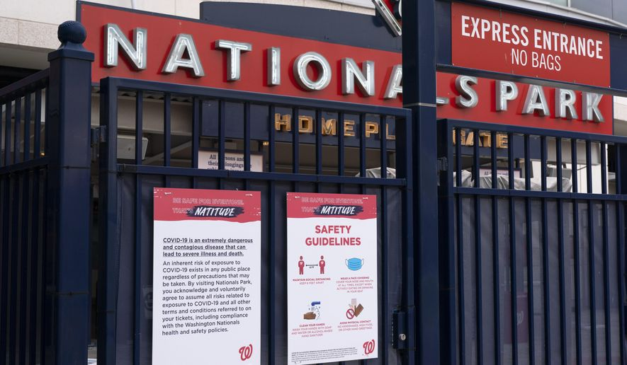 Nationals Park is closed after the opening day baseball game between the Washington Nationals and New York Mets was postponed because of coronavirus concerns. Thursday, April 1, 2021, in Washington. (AP Photo/Jacquelyn Martin)
