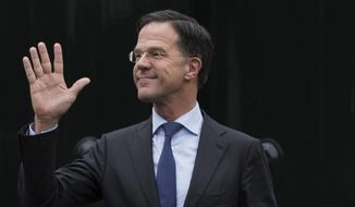 FILE- In this March 15, 2019, file photo, Dutch Prime Minister Mark Rutte waves as he waits for European Council President Donald Tusk to arrive for a meeting at Catshuis residence in The Hague, Netherlands. Caretaker Dutch Prime Minister Mark Rutte was fighting for his political life Thursday in a bitter parliamentary debate about the country's derailed process of forming a new ruling coalition following elections last month. (AP Photo/Peter Dejong, File)