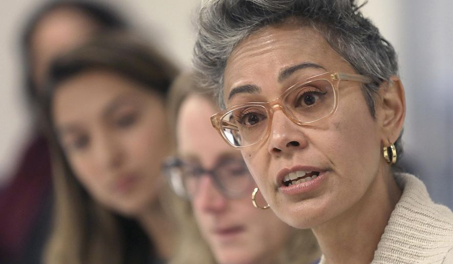 "FILE- In this Sept. 26, 2018 file photo, Alison Collins, right, is seen during an editorial board meeting in San Francisco. Collins the former vice president of San Francisco's school board is suing the district and her colleagues after they voted to strip her of the position because of tweets she wrote in 2016 that said Asian Americans used ''white supremacist"" thinking. The San Francisco Chronicle says Collins filed the suit Wednesday, March 31, 2021, in federal court, alleging violation of her constitutional rights including free speech. She's seeking nearly $30 million. (Liz Hafalia/San Francisco Chronicle via AP, File)"